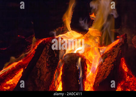 Camp fire - close up of burning wood and intense flames - Stock Photo