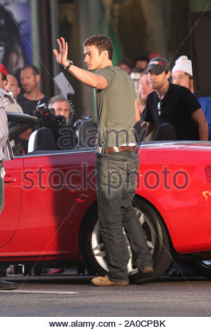 Hollywood, CA - Justin Timberlake and Mila Kunis film scenes for 'Friends with Benefits' on a closed off Hollywood Boulevard. The scene called for Justin and Mila to be in a red convertible sportscar, and between takes the two actors joked and really seemed to be having fun. GSI Media August 26, 2010 - Stock Photo