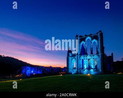 ILLUMINATING RIEVAULX event at Rievaulx Abbey, North Yorkshire, UK. Featuring Museum of the Moon, by Luke Jerram. - Stock Photo
