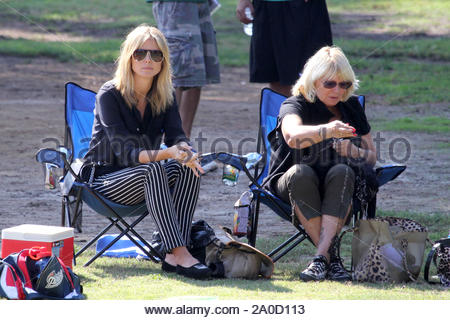 Brentwood, CA - Heidi Klum spends another day on the field with her family where she and her parents watched her son Henry play football. Heidi and her daughter Helene spent some mother daughter time as they sat on the sideline together before Helene took off with friends to start a game of her own. AKM-GSI October 13, 2012 - Stock Photo