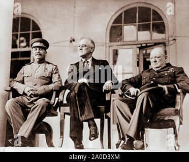 Franklin Delano Roosevelt, Joseph Stalin and Winston Churchill on the portico of the Russian embassy in Tehran, Iran during the Tehran Conference on World War Two held November 28, 1943 through December 1, 1943. - Stock Photo