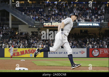 Bronx, United States. 19th Sep, 2019. New York Yankees DJ LeMahieu hits a solo home run in the 2nd inning against the Los Angeles Angels at Yankee Stadium on Thursday, September 19, 2019 in New York City. Photo by John Angelillo/UPI Credit: UPI/Alamy Live News - Stock Photo