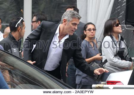 Beverly Hills, CA - Actor George Clooney slips into a handsome suit and films a new commercial for car maker Mercedes Benz in the streets of Beverly Hills. GSI Media September 16, 2011 - Stock Photo