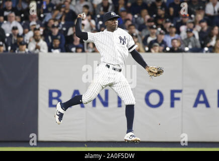 Bronx, United States. 19th Sep, 2019. New York Yankees Didi Gregorius makes a leaping throw to firs base for the out against the Los Angeles Angels at Yankee Stadium on Thursday, September 19, 2019 in New York City. Photo by John Angelillo/UPI Credit: UPI/Alamy Live News - Stock Photo