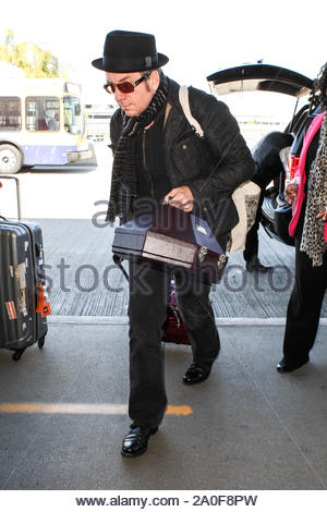 Los Angeles, CA - Rock legend Elvis Costello arrives at Los Angeles International Airport to catch a departing flight. AKM-GSI February 14, 2013 - Stock Photo