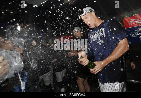 Bronx, United States. 19th Sep, 2019. New York Yankees Aaron Judge celebrates in the club house with champagne after the Yankees defeated the Los Angeles Angels winning the American League East Division at Yankee Stadium on Thursday, September 19, 2019 in New York City. The Yankees advance to ALCS in the MLB postseason Photo by John Angelillo/UPI Credit: UPI/Alamy Live News - Stock Photo