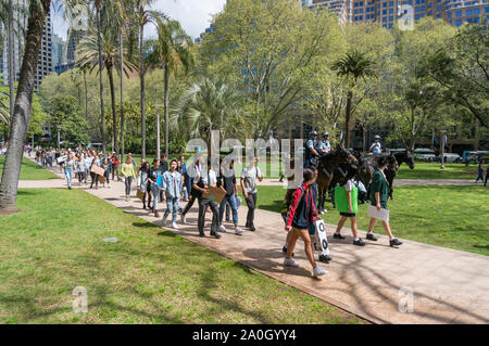 Sydney, Australia - September 20, 2019: Strike for climate change in Sydney. Schoolchildren with placards going for Global climate change strike - Stock Photo