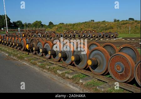 Rows of spare wheelsets for DMU trains and coaches lined up in storage at Quinton Rail Tech Centre - Stock Photo
