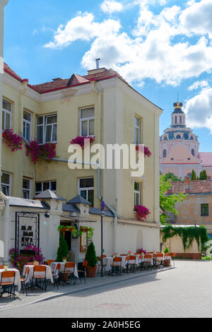 Vilnius, Lithuania - August 19, 2019: View to beautiful streets with stores, restaurants and cafes in old town, Vilnius, Lithuania - Stock Photo