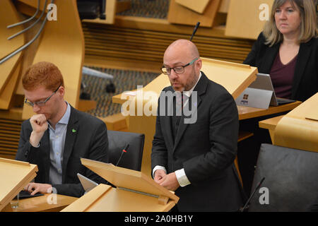 Edinburgh, UK. 19 September 2019. Pictured: (L-R) Ross Greer MSP; (right) Patrick Harvie MSP - Co Leader of the Scottish Green Party.; Alison Johnstone MSP - Co Leader of the Scottish Green Party. Weekly session of First Ministers Questions in the Scottish Parliament tries to steer a path through the fallout of the latest Brexit mess and prevent Scotland from leaving the EU. - Stock Photo