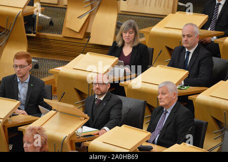 Edinburgh, UK. 19 September 2019. Pictured: (left-right top) Alison Johnstone MSP - Co Leader of the Scottish Green Party.; Mark Ruskell MSP; (left-right bottom) Ross Greer MSP; (right) Patrick Harvie MSP - Co Leader of the Scottish Green Party; John Finnie MSP. Weekly session of First Ministers Questions in the Scottish Parliament tries to steer a path through the fallout of the latest Brexit mess and prevent Scotland from leaving the EU. - Stock Photo