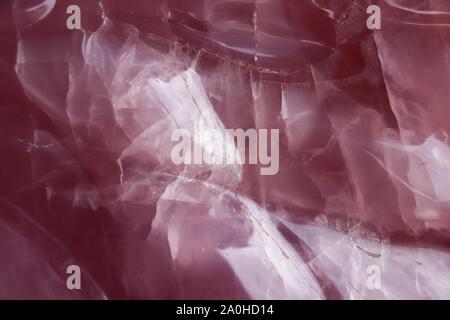Raw uncut Rose quartz crystal close up and texture - Stock Photo