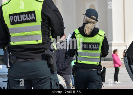 Vilnius, Lithuania - April 06: Police officers in Vilnius Old Town on April 06, 2019 in Vilnius Lithuania. Vilnius is the capital of Lithuania and its - Stock Photo