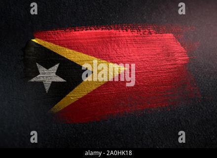 East Timor Flag Made of Metallic Brush Paint on Grunge Dark Wall - Stock Photo