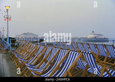 Empty deckchairs along Eastbourne seafront, East Sussex, England, UK. Circa 1980's - Stock Photo