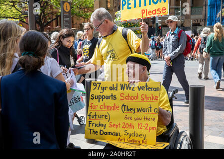 Man in wheelchair holds homemade protest sign at the sydney climate change strike rally,Australia - Stock Photo