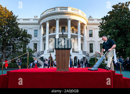 Washington DC, USA. 20th Sep, 2019. A White House employee vacuums the podium area prior to the State Visit of Australian Prime Minister Scott Morrison, in Washington, DC on Friday, September 20, 2019. Credit: UPI/Alamy Live News - Stock Photo
