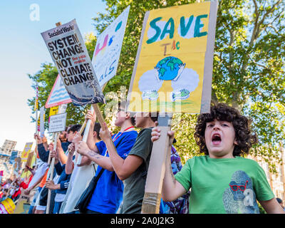 London, UK. 20th Sep, 2019. A general strike for Climate Justice, attended by school children, students and adults, is organised by Extinction Rebellion, Greenpeace, Save the Earth and other groups campaigning for the environment. They are again highlighting the climate emergency, with time running out to save the planet from a climate disaster. This is part of the ongoing ER and other protests to demand action by the UK Government on the 'climate crisis'. The action is part of an international co-ordinated protest. Credit: Guy Bell/Alamy Live News - Stock Photo
