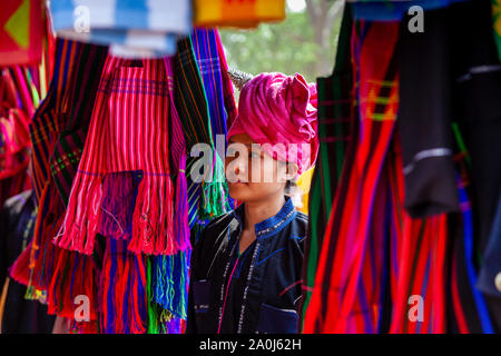 A Young Woman From The Pa'O Ethnic Group Browsing The Market At The Kakku Pagoda Festival, Taunggyi, Shan State, Myanmar. - Stock Photo