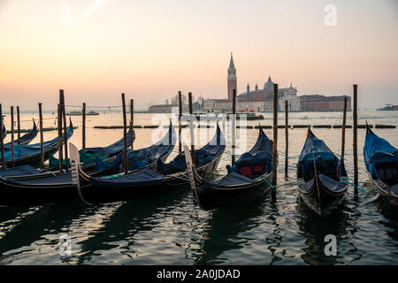 Sunrise in Venice, gondolas and island of St. George view from the square San Marco. Travel.