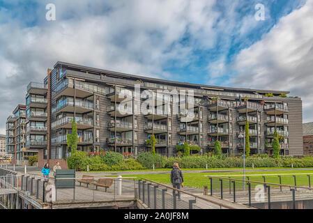 TRONDHEIM, NORWAY - SEPTEMBER 07, 2019: Luxury riverside apartments next to the citys Solsiden area. - Stock Photo