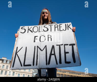 Glasgow, Scotland, UK. 20th September, 2019. A protester holding a placard saying Skolstrejk For Klimatet at the rally held in George Square during the Global Climate Strike demonstration to demand action on the world's climate crisis. Credit: Skully/Alamy Live News - Stock Photo