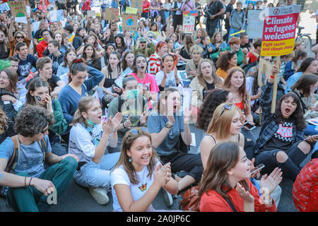 Westminster, London, UK, 20th Sep 2019. Protesters stage a sit down strike outside Downing Street. As the afternoon progresses, protesters make their way down Whitehall, and towards Trafalgar Square. Tens of thousands of children, young people and adults protest for climate action and against the causes of climate change in the British capital. Many similar protests take place in cities around the world in a day of global climate action. - Stock Photo