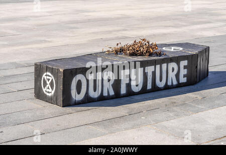 Southampton, UK. 20/09/2019: A black coffin with 'Our Future' written on it and wilted flowers put on top by the Extinction Rebellion Group symbolising a bleak future as we are facing a dying planet as a result of the current climate crisis. Climate strike protest in Southampton, England, UK - Stock Photo