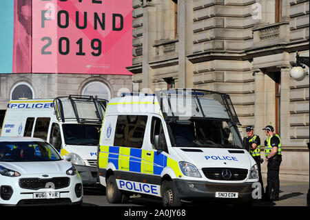 Glasgow, UK. 20 September 2019.  Scenes from a planned protest in George Square this afternoon after strikes started a year ago by 16-year-old Swedish schoolgirl named Greta Thunberg. Hundreds of chalk marked slogans littered the concrete of George Square with protestors from all ages and backgrounds. Credit: Colin Fisher/Alamy Live News - Stock Photo