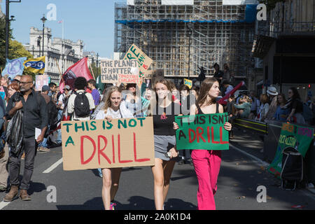 Westminster, London, UK. 20 September 2019. Climate strike protesters demonstrate in Parliament Square as thousands of school children turn out for a global Climate Emergency Strike in London organised by the UK Student Climate Network. The message is for climate justice before the United Nations emergency climate summit on 23 September. - Stock Photo