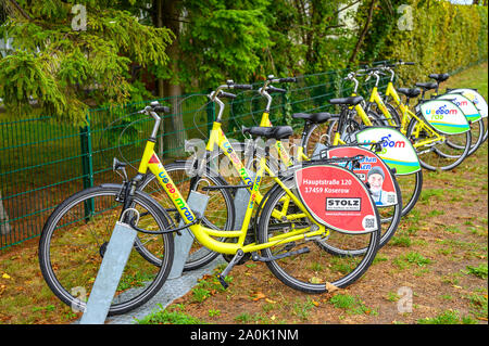 Bansin, Germany - September 13, 2019: Parked rentable bikes in the coastal town Bansin on the island Usedom, Germany. - Stock Photo