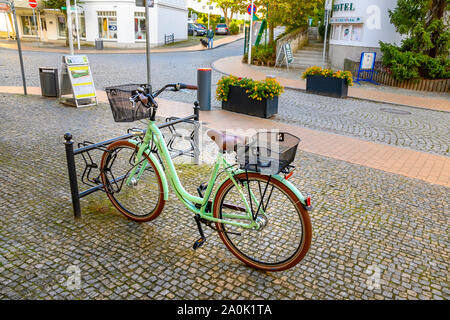 Bansin, Germany - September 13, 2019: Parked green vinatge bike in the coastal town Bansin on the island Usedom, Germany. - Stock Photo