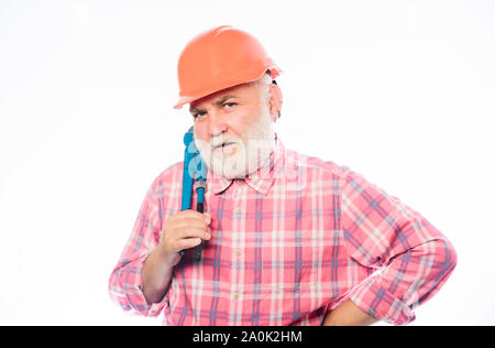 build and construction. bearded man in hardhat. professional repairman in helmet with gas wrench. man builder with adjustable wrench. architect repair. engineer worker. Planning a new construction. - Stock Photo