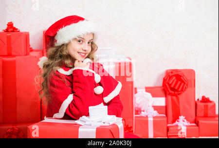 Kid happy with christmas present. Girl celebrate christmas open gift box. Opening christmas gift. Santa bring her gift. Unpacking christmas gift. Happy new year concept. Winter holiday tradition. - Stock Photo