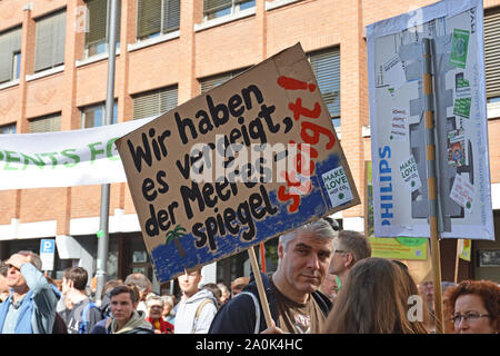 Demonstration during Global Climate Strike with cardboard banner and German slogan saying 'We've blown it, the sea level is rising' - Stock Photo