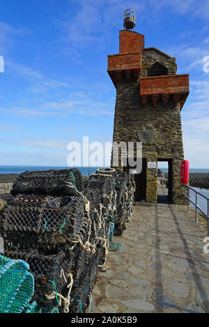 Lobster pots on the harbour wall at Lynmouth - Stock Photo