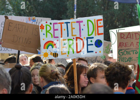 Demonstration during Global Climate Strike with cardboard banner saying 'Save the planet' in German - Stock Photo
