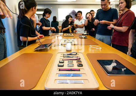 Customers look at Apple's new iPhone 11 series smartphones at an Apple retail store at the IFC Mall in Pudong New Area, Shanghai. Apple launched sales of its latest iPhone 11, iPhone 11 Pro and iPhone 11 Pro Max in China. - Stock Photo