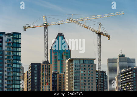 Montreal, CANADA - 19 September 2019: Buildings under construction in Montreal Downtown, with 1000 De La Gauchetiere Building in the background. - Stock Photo
