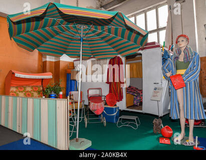 Trebus, Germany. 19th Sep, 2019. A caravan 'Friedel' and other camping utensils from GDR times belong to an exhibition of the IFA friends Trebus. The former German state on a small scale exists in the Brandenburg province. The IFA friends in Trebus will be offering an authentic journey through time into everyday life in the GDR on 14,000 square metres of space. Visitors indulge in memories during guided tours. Credit: Patrick Pleul/dpa-Zentralbild/ZB/dpa/Alamy Live News - Stock Photo