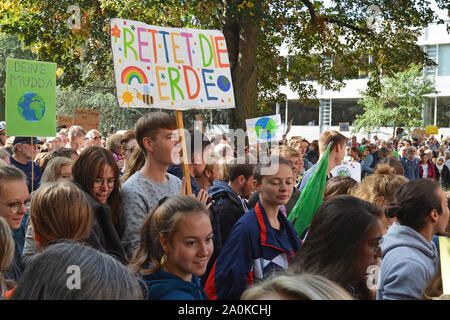 Young Demonstrants with protest signs gathering during Global Climate Strike  in Heidelberg, Germany