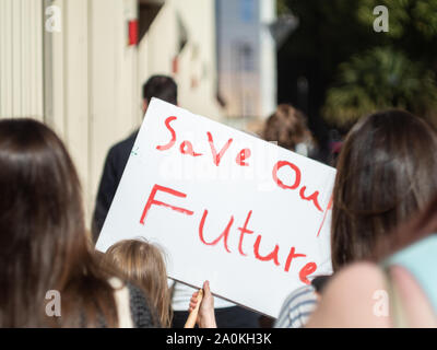 LONDON, UK - SEPTEMBER 20 2019: Young girl holding a handwritten sign that reads 'Save our future' at the Global Climate Strike in London - Stock Photo