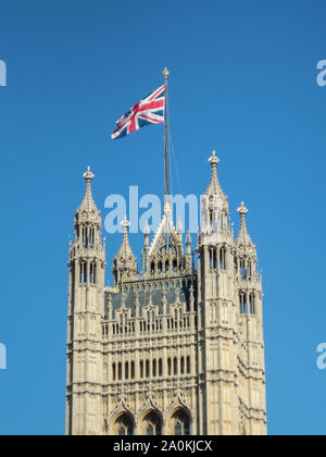 LONDON, UK - SEPTEMBER 20 2019: Union Jack flag flying over the Houses of Parliament against a blue sky, Westminster, London - Stock Photo