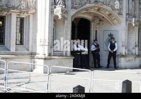 London, UK. 20 September 2019. Police on duty outside the Supreme Court in near Parliament Square. Around 100,000 people, led by school children on strike, marched in Westminster, London, calling for urgent action to combat the climate crisis. Similar protests were held across the UK, and around the World. © Stuart Walden/ Alamy - Stock Photo