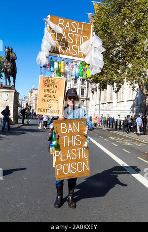 20 September 2019, London, UK - Man with signs calling to ban plastic at the Global Climate Strike in Westminster - Stock Photo