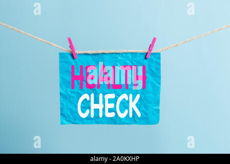 Writing note showing Health Check. Business concept for Medical Examination Wellness and general state Inspection Clothesline clothespin rectangle sha - Stock Photo