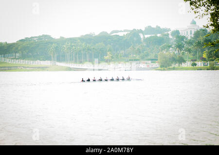 Putrajaya, Malaysia - September 6, 2019: Dragon boat racer practice at the lake near Taman Botani. - Stock Photo