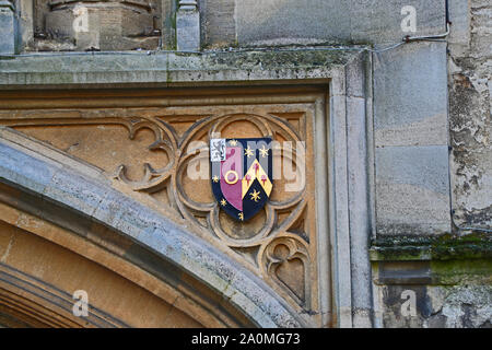 Coat of arms of St John's College Oxford sculpted in stone above the college entrance in St Giles' a constituent college and the wealthiest