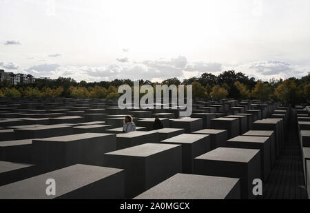 Beijing, Germany. 19th Sep, 2019. A man and a woman walk across the Memorial to the Murdered Jews of Europe in Berlin, capital of Germany, Sept. 19, 2019. Credit: Shan Yuqi/Xinhua/Alamy Live News - Stock Photo