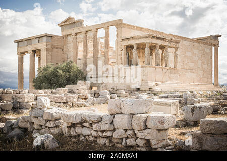 Ionic marble Erechtheion and the Porch of the Caryatids, Acropolis, Athens, Greece - Stock Photo